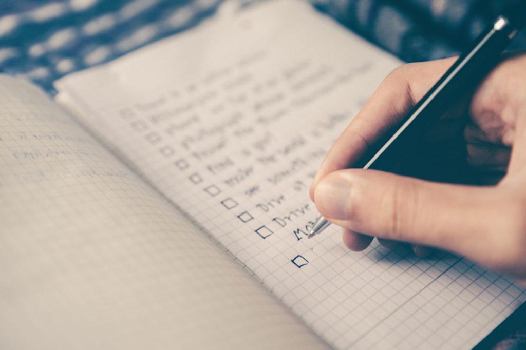 Man writing a to do list